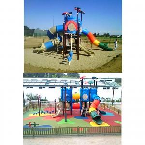 MODUS Mega Spielturm mit Tunnelrutsche auf einem Sandspielplatz
